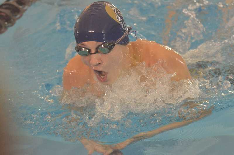 HERALD FILE PHOTO: COREY BUCHANAN - Canby swimmer Michael Haring placed sixth in state in the boys individual medley and helped the Cougars' medley relay team place fifth.