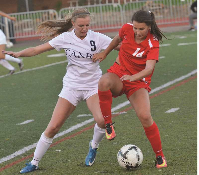 HERALD FILE PHOTO: COREY BUCHANAN - Canby midfielder Mackenzie Lee jostles for the soccer ball.