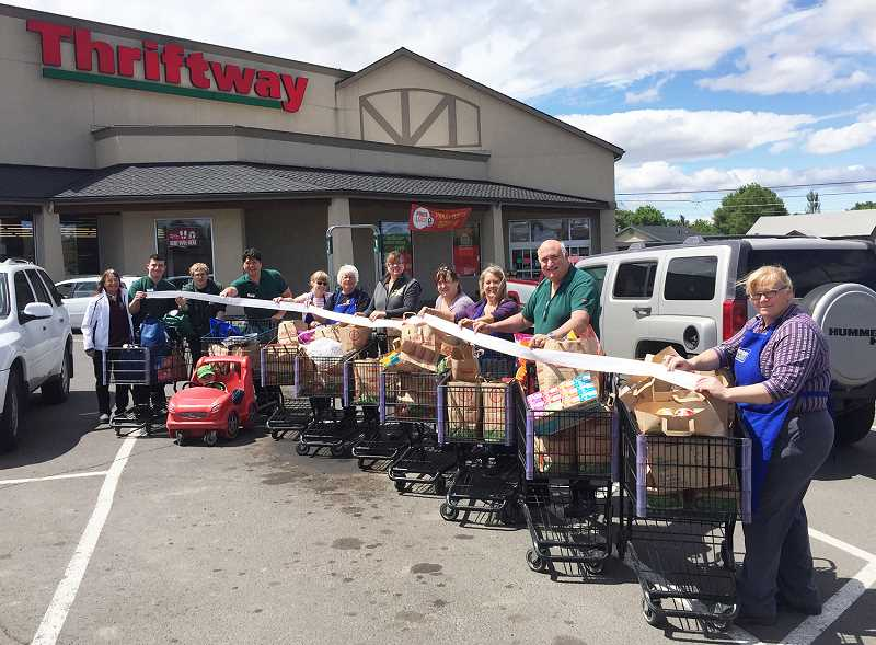SUBMITTED PHOTO - Farm Bureau members pose with Erickson's Thriftway staff and the groceries that were purchased.