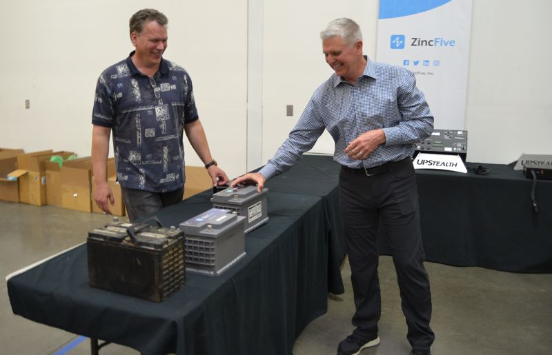 PAMPLIN MEDIA GROUP: JULES ROGERS - Dan Sisson (left) and Tim Hysell compare the weight of their battery to old tech that weighs twice as much and is still widely used.
