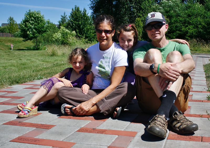 FILE PHOTO - Carol Cohen, second from left, is shown in this undated photo with her family at Sandy Bluff Park, the site of the Noah's Quest run/walk to benefit Brief Encounters.