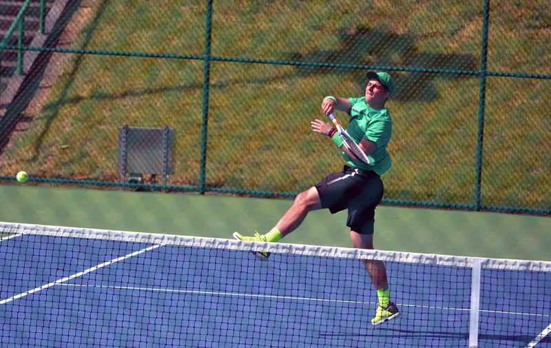 TIMES FILE PHOTO - Jesuit senior Michael Quinn won four Class 6A doubles championships during his career as a Crusader.