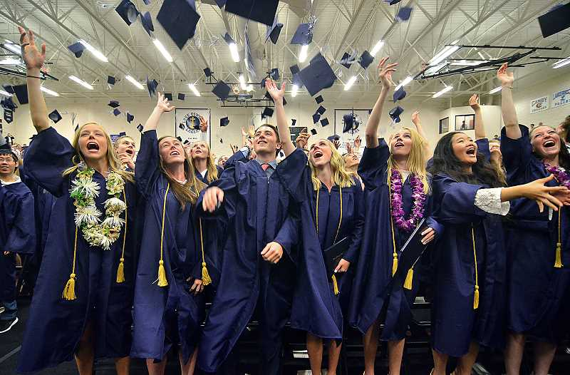 REVIEW FILE PHOTO: VERN UYETAKE - Lake Oswego High School students celebrate being a member of the Class of 2017 at commencement on June 1.