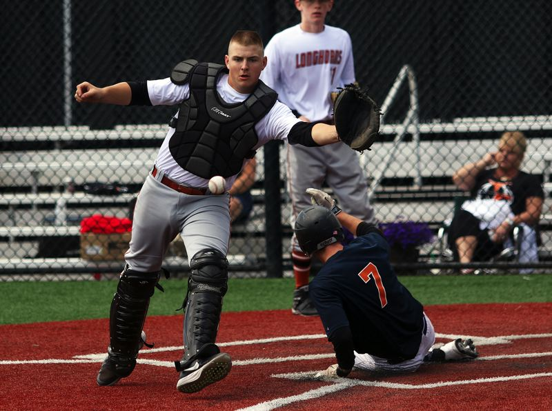 DAN BROOD - Suburban Door's Chris Freese (7) slides safely to home plate as Tigard catcher C.J. Rivers reaches for the ball during Saturday's OIBA game. The Tualatin squad scored an 8-2 victory.