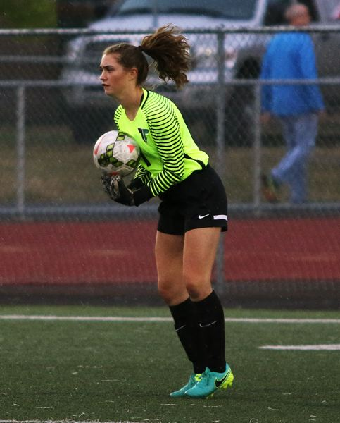 DAN BROOD - Lexie Sawin makes a save for the Tigard girls soccer team during a match this past fall.