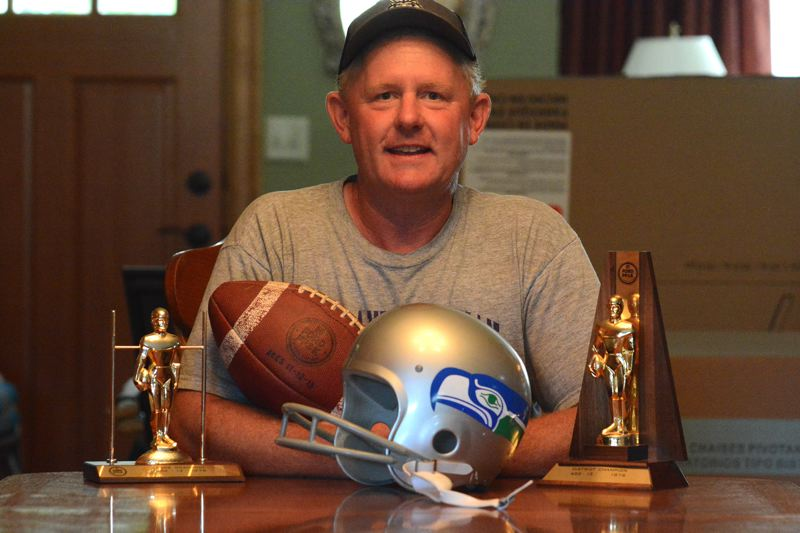 OUTLOOK PHOTO: DAVID BALL - Ryan Beliel still has the football uniform and football from his Punt, Pass and Kick appearance at the Kingdome in 1976 — the Seattle Seahawks inaugural season.