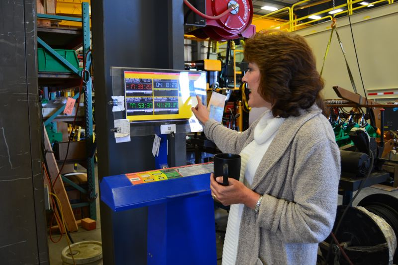 PAMPLIN MEDIA GROUP: JULES ROGERS - Bradley demonstrates how the award-winning software keep track of timeclocks and projects in a color-coded system easy for supervisors to read.