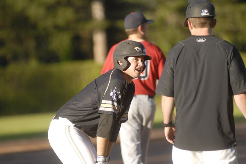 GRESHAM OUTLOOK: MATT RAWLINGS - Greywolves shortstop Dylan Doherty talks with coach Justin Barchus after reacing third base in Gresham's 10-2 loss to Wenatchee.