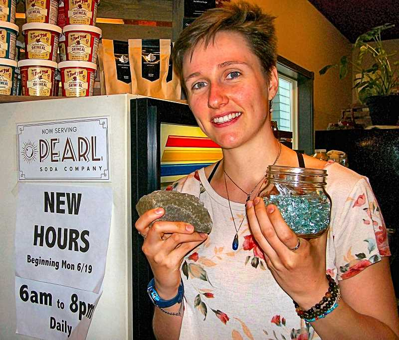RITA A. LEONARD - Barista Tasha Addington-Ferris displays the rock that a burglar threw through Rose City Coffees Westmoreland front door, and a jar of the collected broken glass it scattered on the floor. Shes hopeful the June 22 arrests in North Portland will put an end to such burglaries in Southeast.
