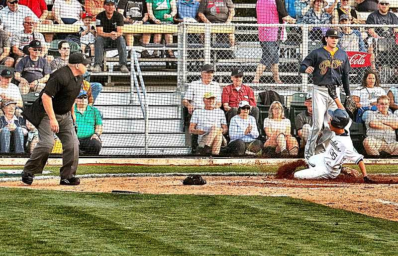 (Image is Clickable Link) DAVID F. ASHTON - Clackamas Community College freshman Berry Hunt slides into home base, scoring another run for the Portland Pickles.