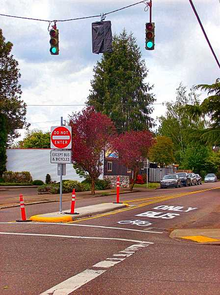 RITA A. LEONARD - The new traffic lights, signs, and a new concrete barrier at S.E. 28th and Holgate Boulevard indicate a new northbound bike route.