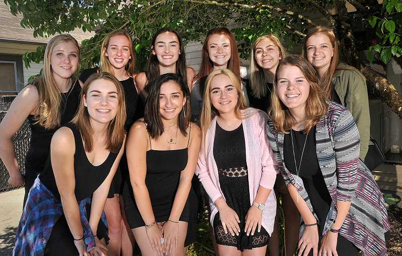 REVIEW PHOTO: VERN UYETAKE - Female members of Lakeridge High School show choir, Company, beam after performing at the Oregon House of Representatives during the opening ceremony on June 22.