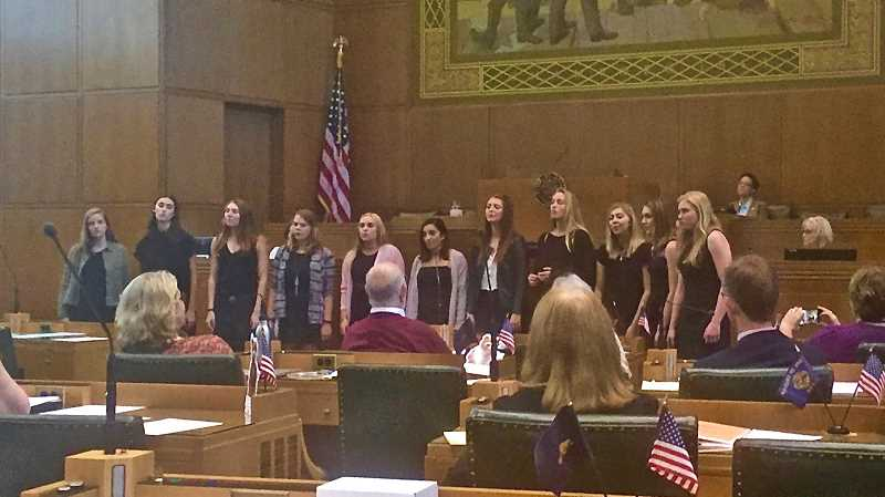 SUBMITTED PHOTO: COURTESY OF ANN LININGER - Lakeridge Company members perform Milck's 'I Can't Keep Quiet' from the Women's March in D.C. last week in front of the Oregon House of Representatives.