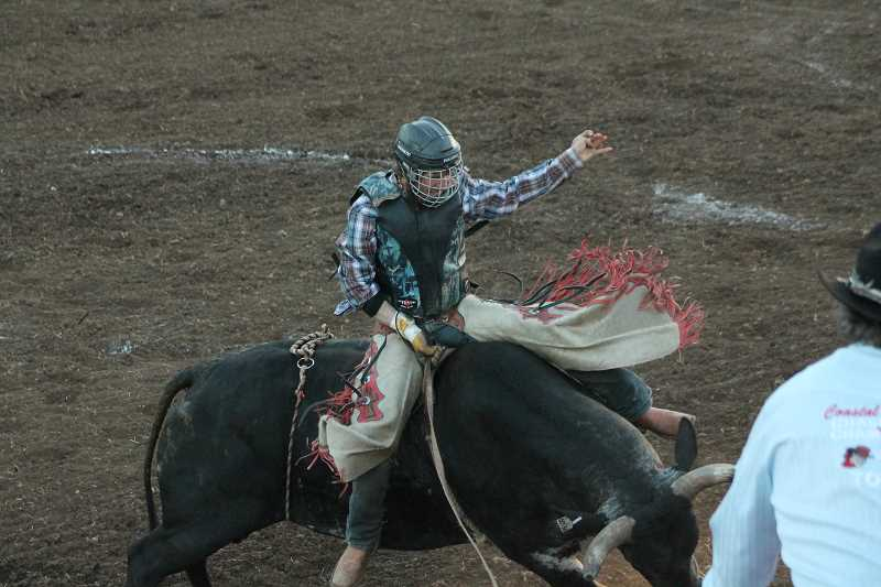 PIONEER PHOTO: CONNER WILLIAMS - Montana Barlow took first in the bull riding on Saturday at the Coastal Farm and Ranch Challenge ofChampions Tour as he earned 85 points.