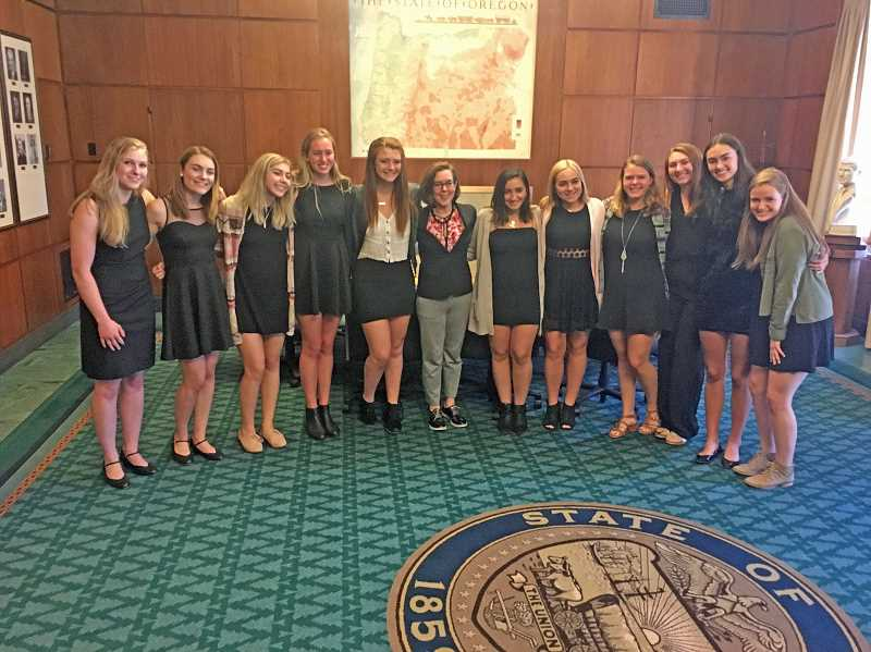 SUBMITTED PHOTO: STEPHANIE FOSTER - Pacers pause to spend a moment with Gov. Kate Brown (center). The Lakeridge Company ladies also sang 'Happy Birthday' to Brown on the same day they performed before the Oregon House of Representatives.
