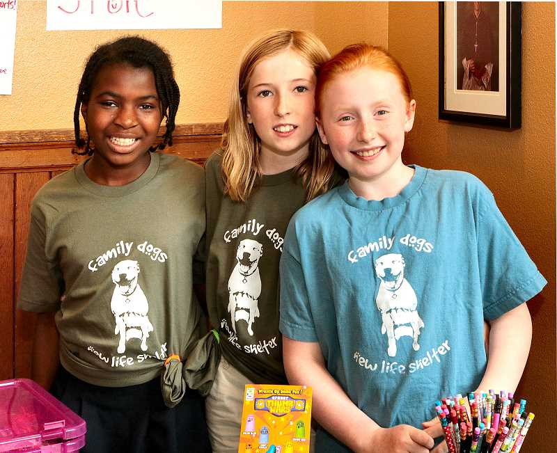 DAVID F. ASHTON - Ready to open their store on June 14, to raise money for a no-kill dog shelter for the last time this school year, were St. Agatha Catholic School fourth grade students, from left, Justine Pashley, Josie Maitland, and Genevieve Westerback.
