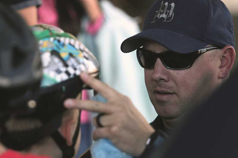 PHIL HAWKINS - Woodburn firefighters helped fit helmets on children at the Gervais Bicycle Rodeo.