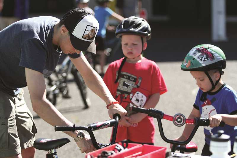 PHIL HAWKINS - After completing the bicycle safety course, participants were treated to a free bicycle tune up.