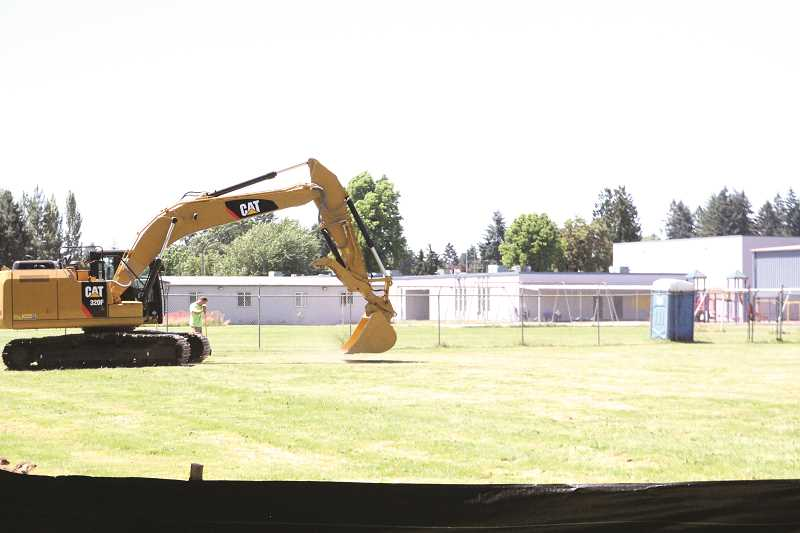 INDEPENDENT PHOTO: LINDSAY KEEFER - Construction is beginning at Washington Elementary School, which already saw the demolition of two neighboring houses, purchased by Woodburn School District. The project won't be complete before the end of next summer.