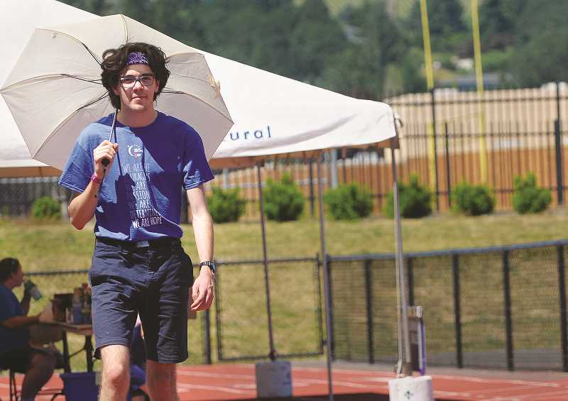 GARY ALLEN - A walker does his best to beat the oppressive heat during the Relay for Life on Saturday.