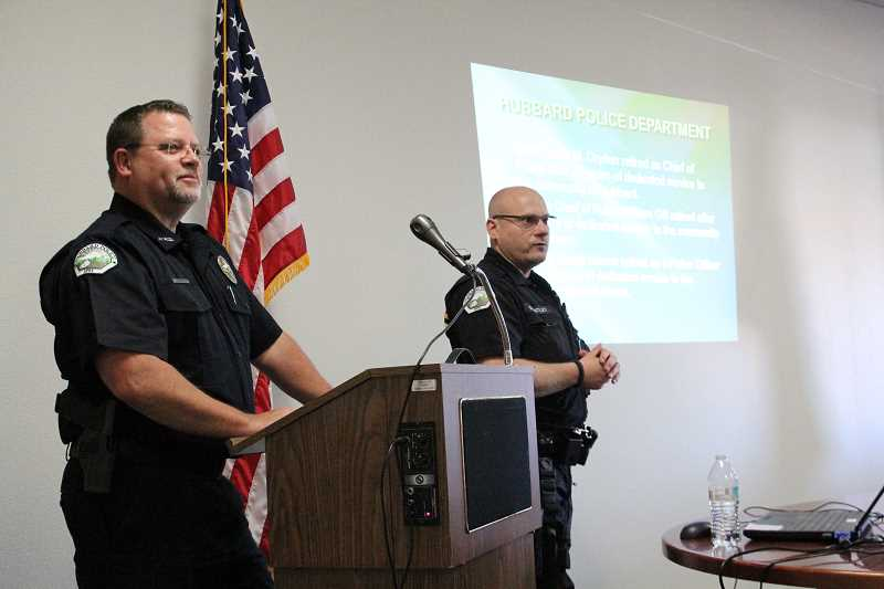 LINDSAY KEEFER - Hubbard Police officers Chris Anderson (left) and Glen Bentley answer questions from the audience at the close of their presentation on what they do in the community.