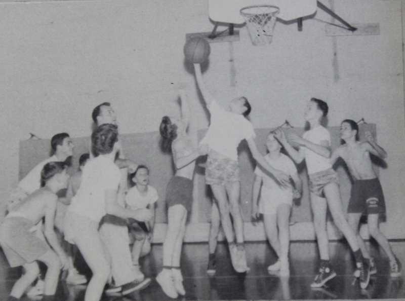 SUBMITTED PHOTO - Students play a game of basketball in the Sunset gym in the '60s. Sunset's gym, built in 1930, remained in use until this past school year.