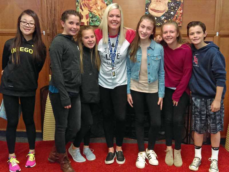 REVIEW PHOTO: JILLIAN DALEY - Here is a sample of the Friendly Falcons at Forest Hills Elementary and the groups leader. These Falcons are (from left): Victoria Li, Maddie Douglass, Kate Pulley, school counselor Hayley Drimmel, Lauren Vance, Payton Cavagnaro and Maxwell Brauner.