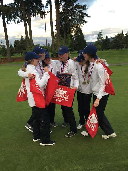 SUBMITTED PHOTO - Wilsonville girls golfers celebrate the program's first-ever state title at Emerald Valley Golf Club in May.