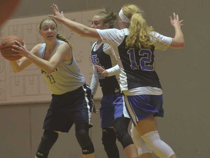 HERALD PHOTO: COREY BUCHANAN - Canby rising senior Cassidy Posey surveys the defense against La Salle.