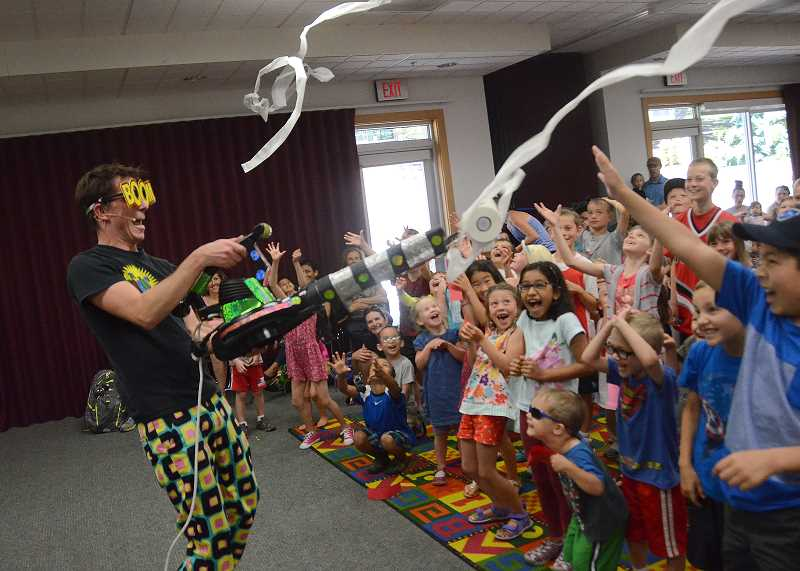 SPOKESMAN PHOTO: VERN UYETAKE - Zerby delights the the crowd at the Wilsonville Library this finishing act.