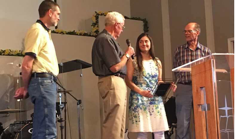 SUBMITTED PHOTO - Presenting the Awana award are, from left, Dave Colburn, Awana commander, Larry Hyder, past commander, recipient Jessica Dawes, and Gordon Nicholson, Awana Journeys director.