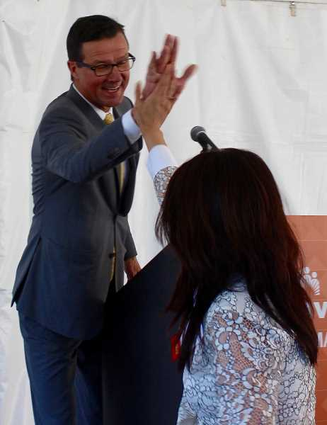 THE TIMES: MANDY FEDER-SAWYER -  Imelda Dacones, M.D., CEO and President, Northwest Permanente, P.C. and John Snyder, DMD, Dental Director and CEO, Permanente Dental Associates share a high-five during the groundbreaking event for the new facility in Beaverton.