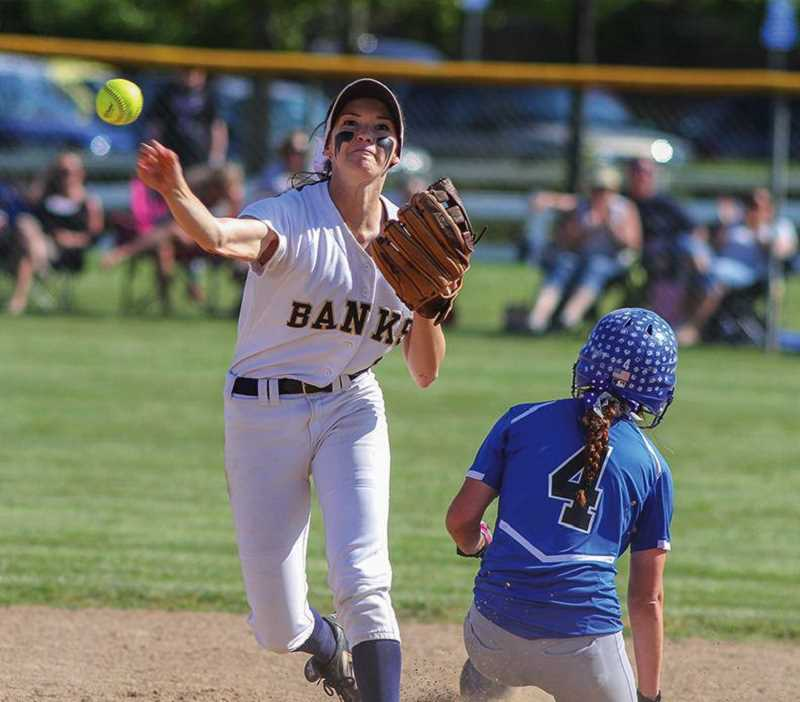 NEWS-TIMES FILE PHOTO - Then Banks shortstop MaKenna Partain turns a double play during a game against Mazama. Partain is now a standout second baseman for the University of Minnesota Golden Gophers.