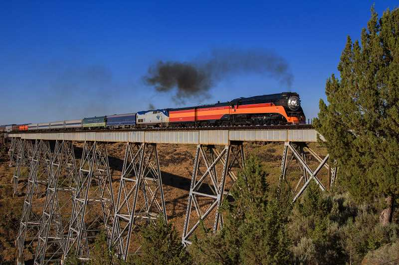 PHOTO BY DAVID BROWNELL - The Daylight locomotive crosses the Madras trestle, headed toward Bend, on Saturday evening.
