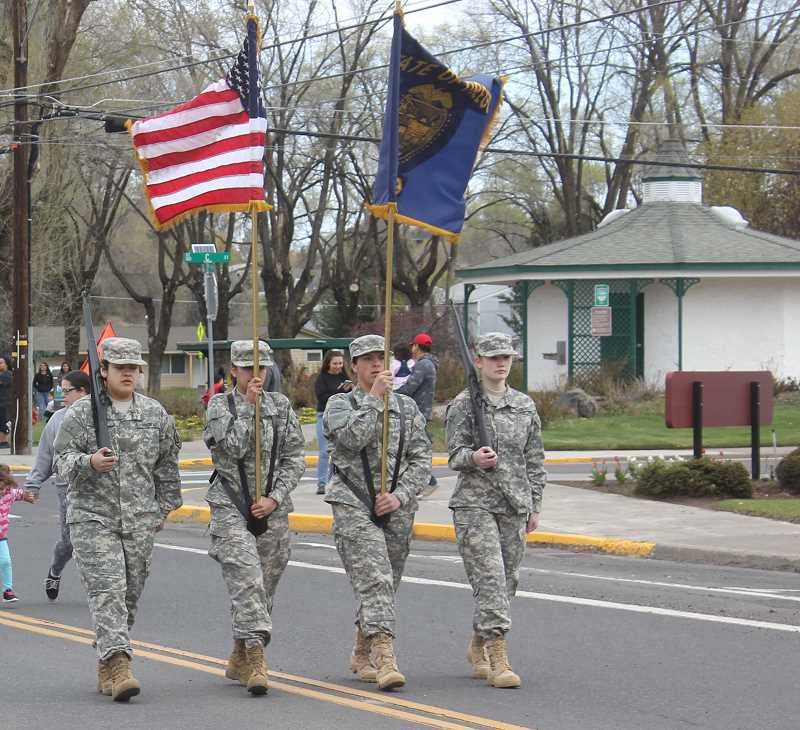 FILE PHOTO - The JROTC color guard has led local parades for years, and cadets regularly participate in community service projects.
