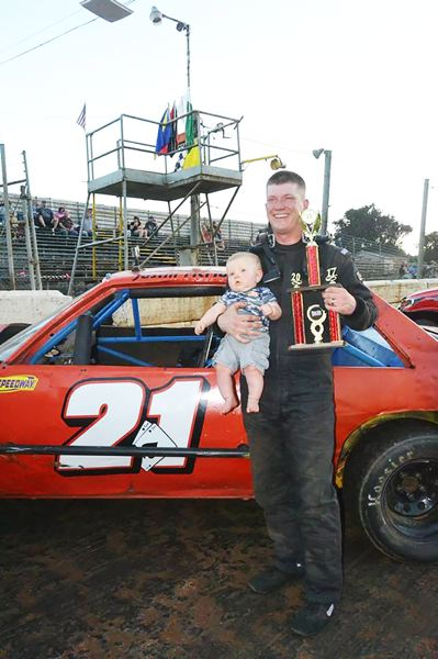 PHOTO CREDIT: L.A.B. PHOTOGRAPHY - Justin McMullen, 27, of St. Helens, celebrates back-to-back Street Stock main wins.