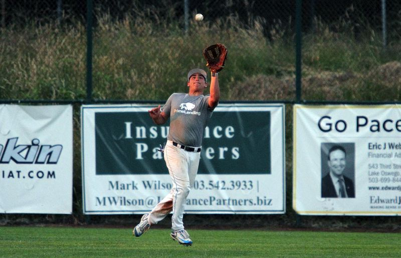 REVIEW PHOTO: MILES VANCE - Lakeridge's Jacob Groman makes a running catch in the outfield during his team's 5-4 win over Perth, Australia, on Tuesday at Lakeridge High School.