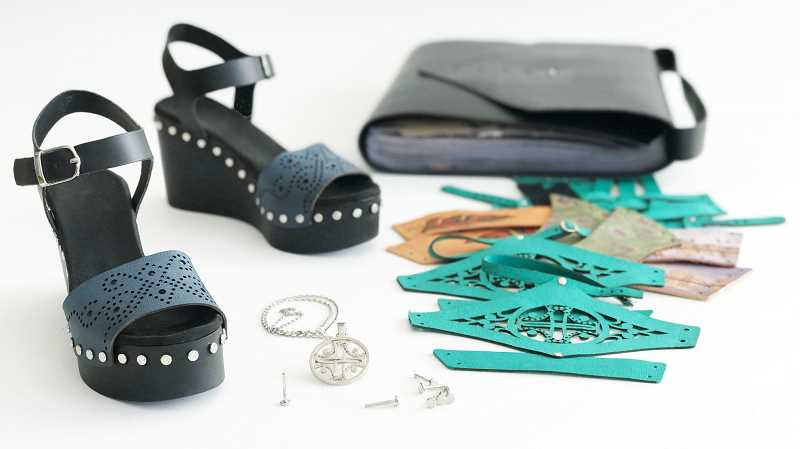 SUBMITTED PHOTO - Platforms for Change allows wearers to adjust the top of their shoes as they please. The pendant featuring the companys logo serves as a tool to remove the rivets holding the toppers in place. More than 20 different tops fit in the travel-friendly case, allowing endless combinations of footwear for women on the go.