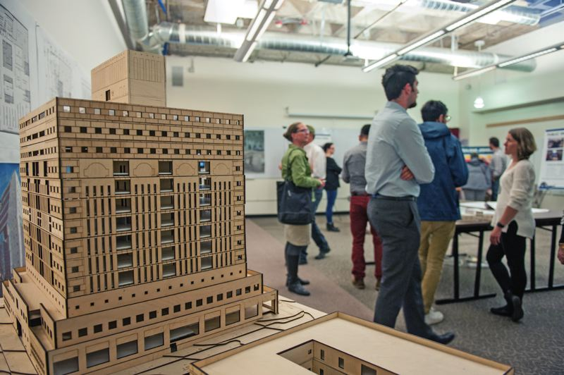PAMPLIN MEDIA GROUP: JOSEPH GALLIVAN - A model of the Portland Building on display at an open house in May 2017. Project Manager Kristin Wells (right, in white) talks to a member of the public about the design. She spoke Monday to persuade four members of the Historic Landmarks Commission that the proposed changes are the best thing for both the original intent of the building and for the people who have to work in it.