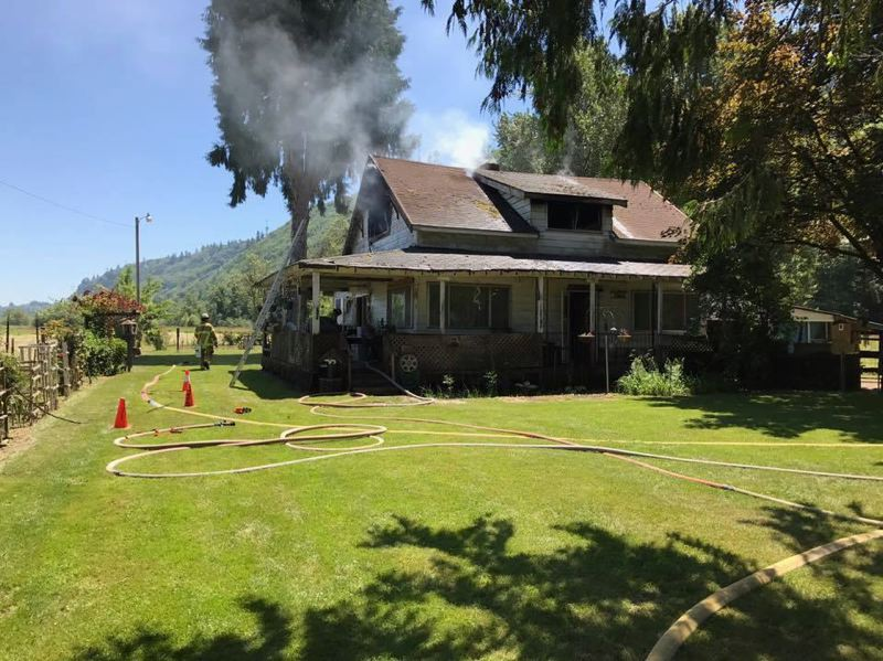 PHOTO COURTESY OF COLUMBIA RIVER FIRE AND RESCUE - Columbia River Fire and Rescue crews responded to a house fire in Rainier where the blaze caused hundreds of thousands of dollars of damage to the two-story structure on June 24. The cause of the fire is undetermined.