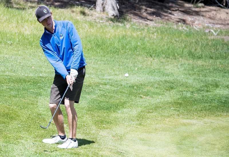 LON AUSTIN/CENTRAL OREGONIAN - Mayson Tibbs chips onto a green at Eagle Crest Resort in a tournament early this spring. Tibbs, a senior, finished third at the state championshiops each of the past two years.