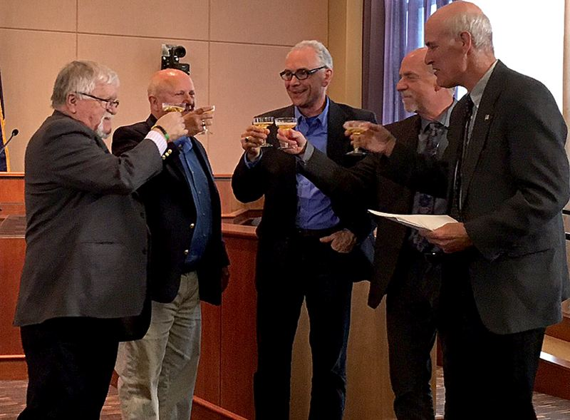 PAMPLIN MEDIA GROUP: PETER WONG - A toast (of sparkling apple juice) concludes the signing ceremony Wednesday, June 28, for an agreement shaping the future of the Stafford urban reserve area. From left, Metro Council President Tom Hughes, Clackamas County Board Chairman Jim Bernard, Tualatin Mayor Lou Ogden, West Linn Mayor Russ Axelrod, Lake Oswego Mayor Kent Studebaker.