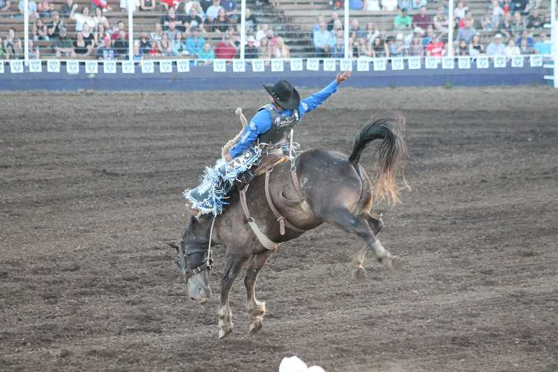 PIONEER PHOTO: CONNER WILLIAMS  - Nick LaDuke took the lead Saturday night with an 82-point performance in the saddle bronc riding during the opening night of the 2017 Molalla Buckeroo Rodeo.
