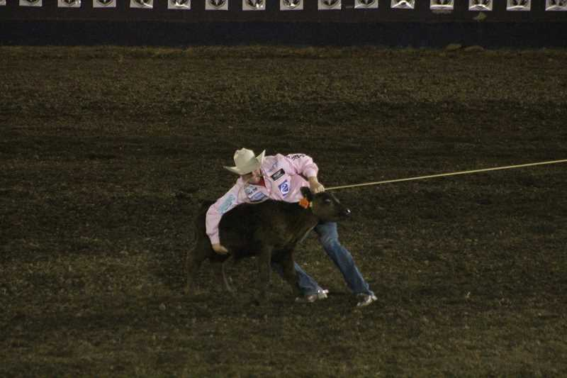 PIONEER PHOTO: CONNER WILLIAMS  - Tyson Durfey, last year's tie-down roping champion, is currently on pace to defend his title as he sits in first with a time of 8.6 seconds during the opening night of the 2017 Molalla Buckeroo Rodeo.