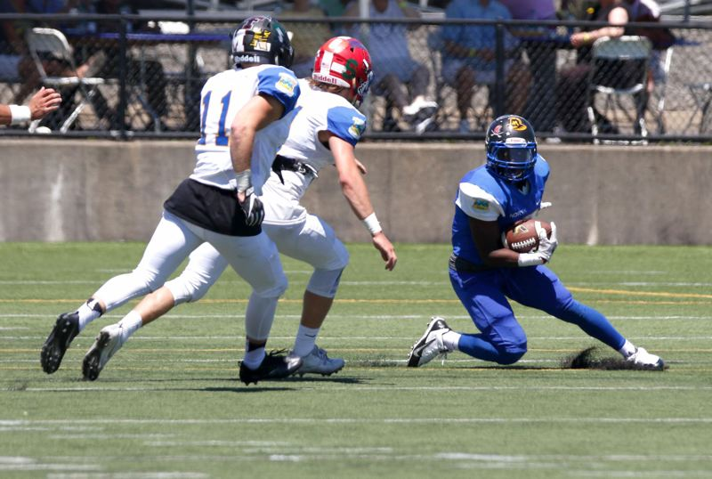 TRIBUNE PHOTO: JONATHAN HOUSE - Terrell 'Rayray' West from Jefferson High makes a play for the North all-star team in the annual Les Schwab Tires Bowl at Hillsboro Stadium.