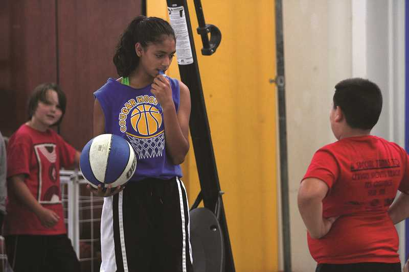 PHIL HAWKINS - Gervais incoming freshman Celi Vasquez (left) is one of many varsity Gervais girls basketball players who have been a part of the annual Gervais Hoop Camp for years and are now helping to run it for the next generation of basketball players in the region.
