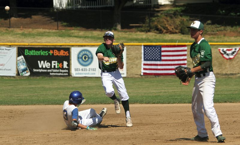 TIDINGS PHOTO: MILES VANCE - West Linn shortstop James Marshall turns a double play during his team's 6-1 win over Aloha in the Firecracker Classic tournament at Lakeridge High School on Saturday.