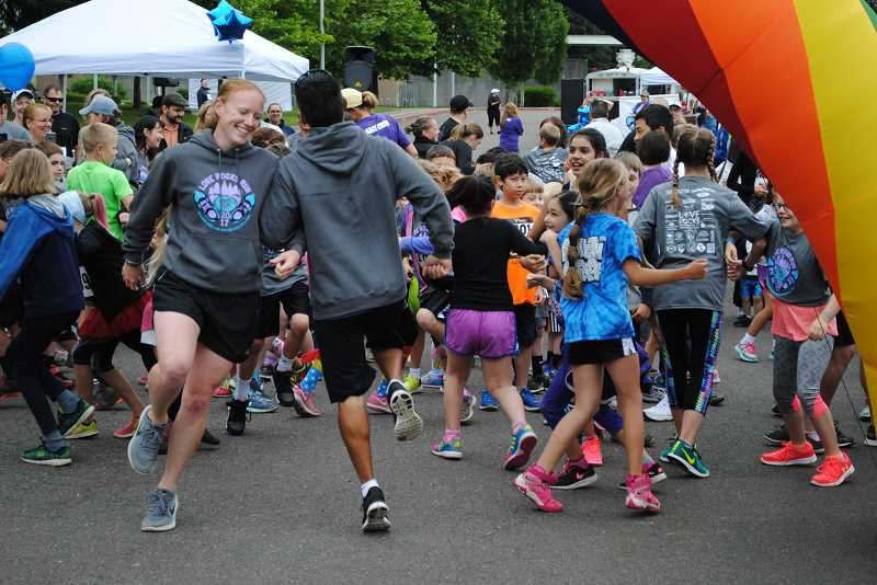NEWS-TIMES PHOTOS: EMILY GOODYKOONTZ -  006: Volunteers lead youngsters in a rousing rendition of the chicken dance before the run.
