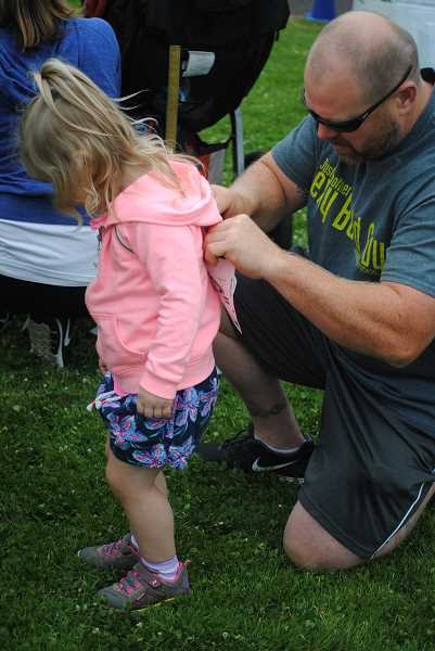 NEWS-TIMES PHOTOS: EMILY GOODYKOONTZ - 008: A dad pins a runner number on his daughter.
