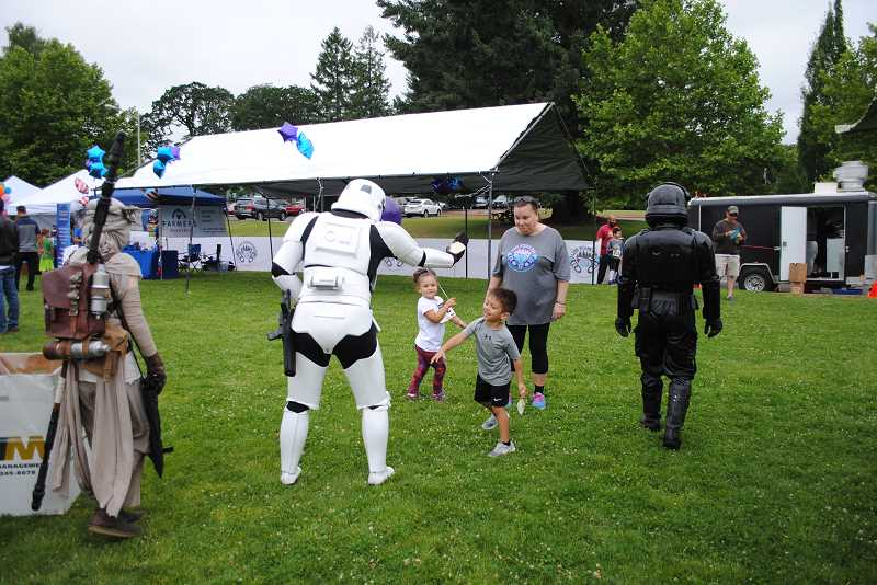 NEWS-TIMES PHOTOS: EMILY GOODYKOONTZ - Star Wars characters provided heaps of fun, play and high fives for kids at the Love Rocks Run.
